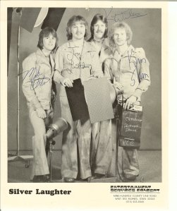 Once again, matching suits. Here is an autographed photo from that era. Pictured here are Mick, Jon, Ken and Kim.