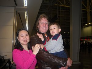 Ken Wiles with his wife, Yan, and young sun, Steven.