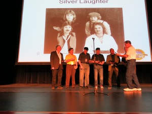Silver Laughter getting our awards - The guy in white got most of our names wrong!