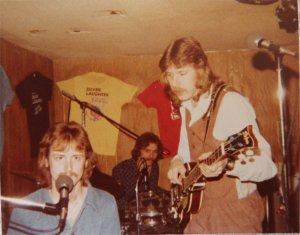 Mick, Paul and Ken during a piano song