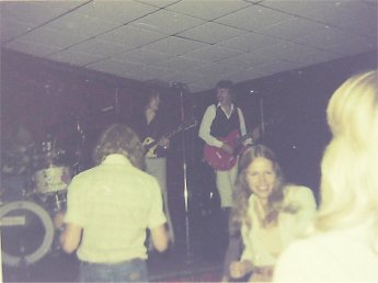Kim, Jon and Ken onstage 1976