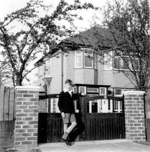 John Lennon posing in front of Aunt Mimi's House