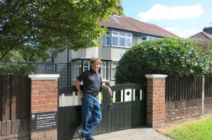 Mick in front of John Lennon's teenage home