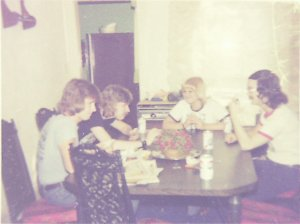 Mick, Ken, Becky and Carl playing cards before dinner